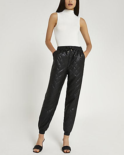 Black faux leather quilted joggers