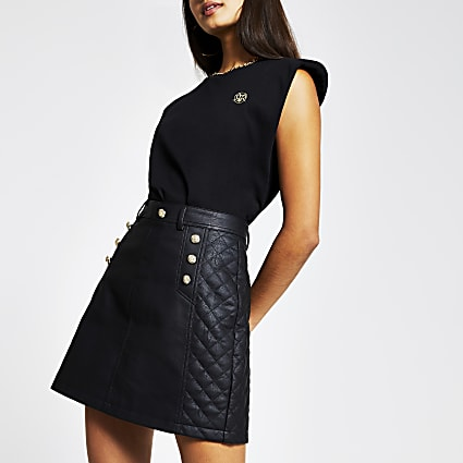 Black faux leather quilted mini skirt