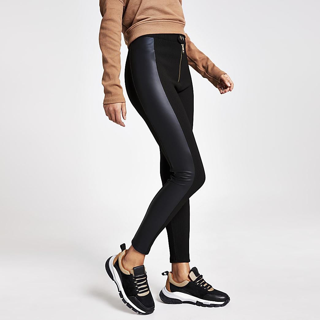 Leggings noirs en cuir synthétiqueet tissu côtelé contrastants