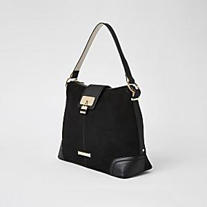 Zwarte imitatiesuèderuime tas met slot voorop