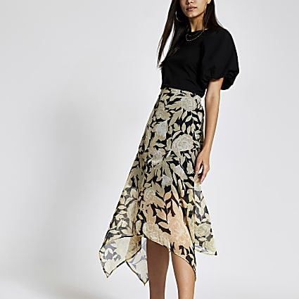 Black floral asymmetric hem midi skirt