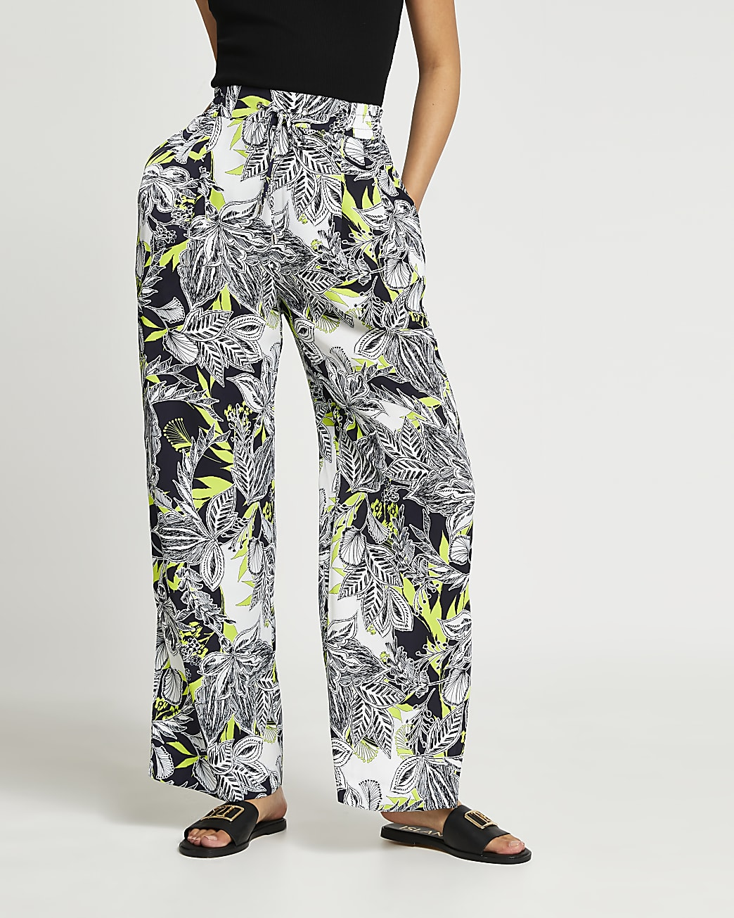 Black floral print pleated wide leg trousers