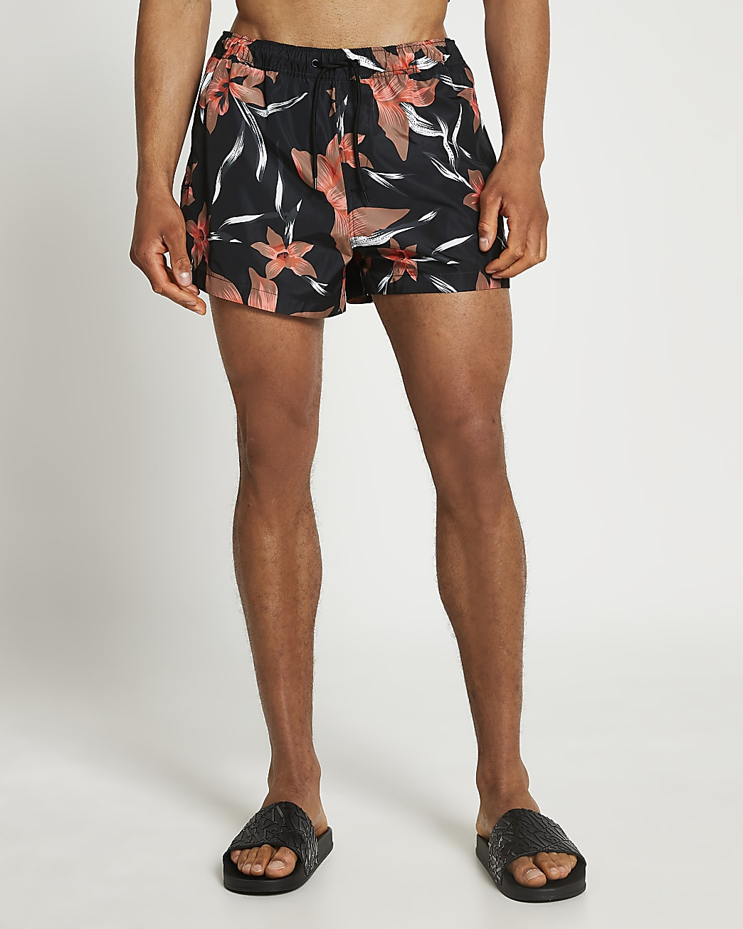 Black floral print swim shorts