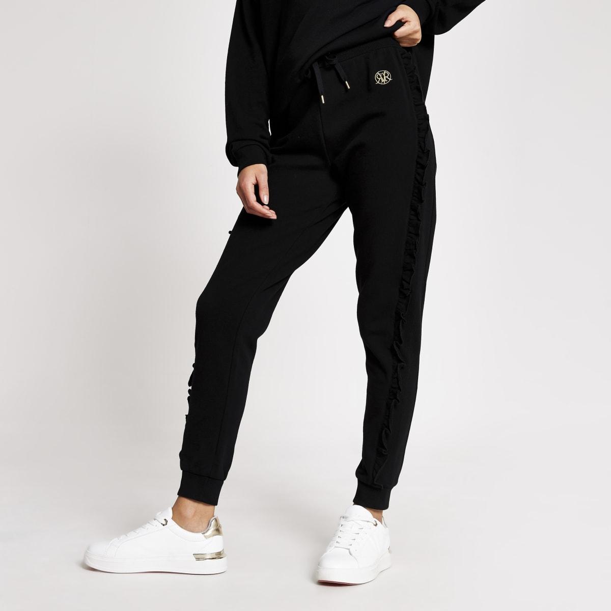 Zwarte joggingbroek met ruches aan zijkant en RI-print