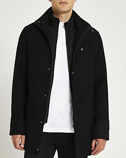 Black funnel neck wool coat