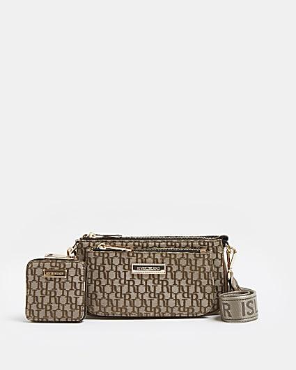 Black geometric embossed patent tote bag
