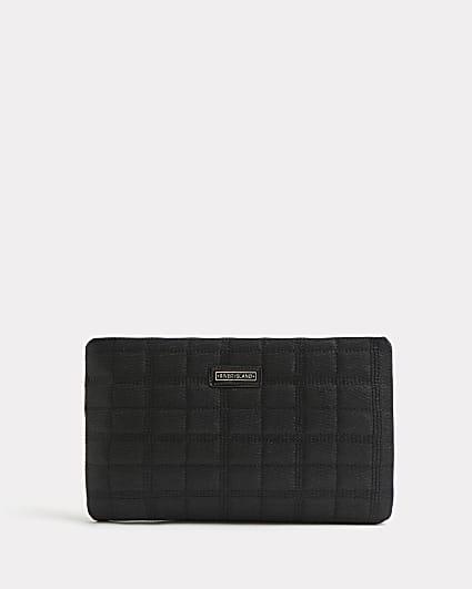 Black glitter quilted clutch bag