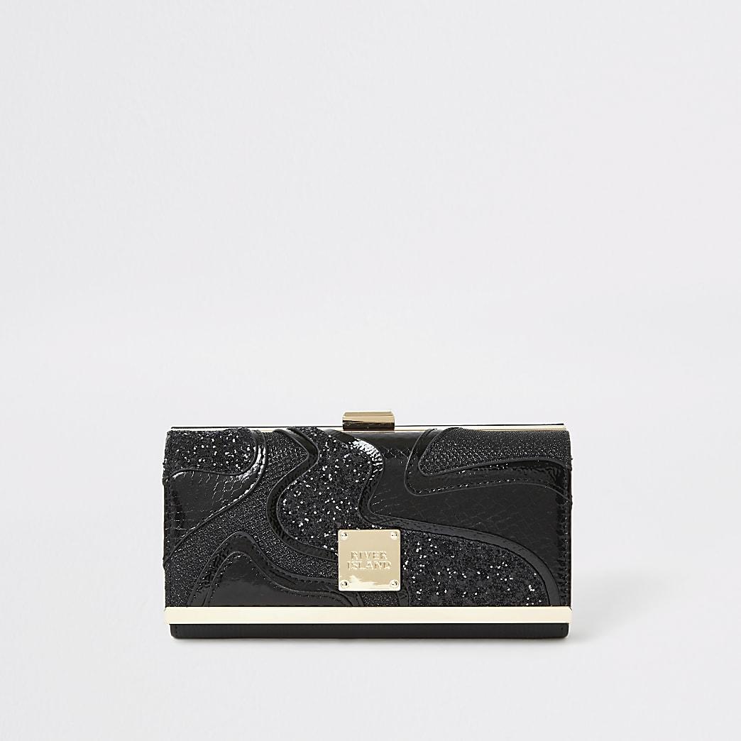 Schwarze, glitzernde Geldbörse mit oberem Clipverschluss und Cutabouts