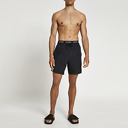 Black graphic print swim shorts