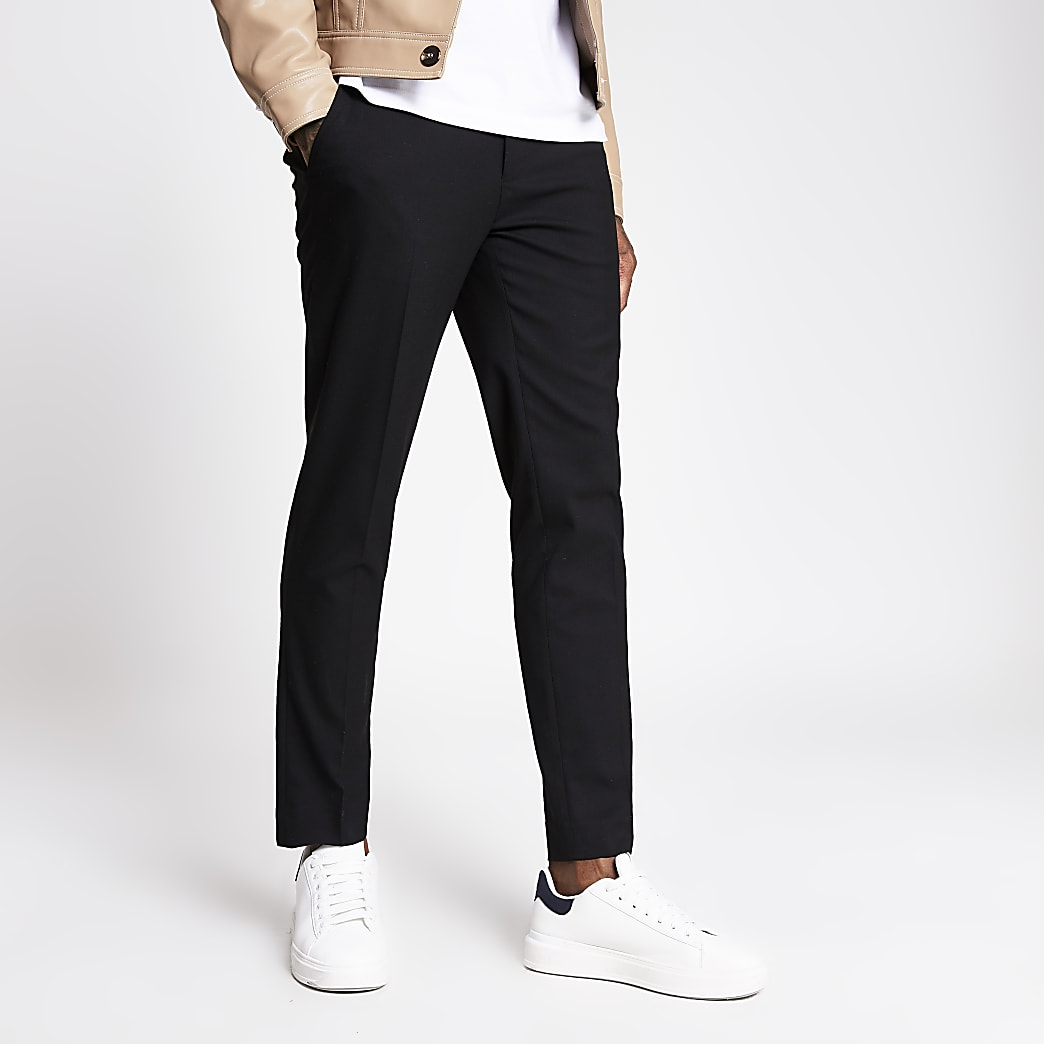 Black herringbone skinny trousers