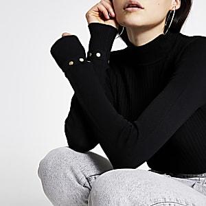 Zwarte hoogsluitende aansluitende geribbelde gebreide trui