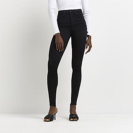 Black high waisted split zip hem skinny jeans