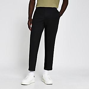 Zwarte smaltoelopende broek van Jersey stof