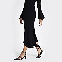 Black knit rib asymmetric hem midi skirt