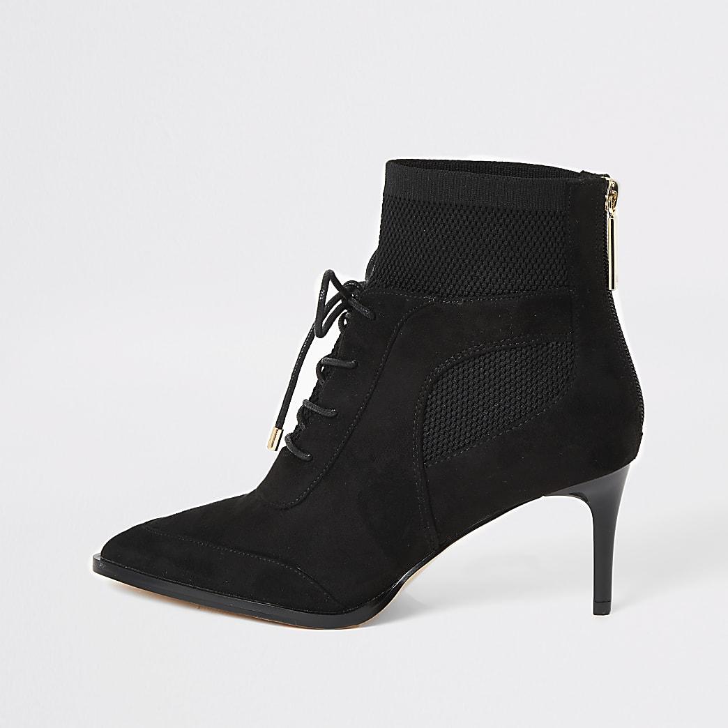 Zwarte gebreide laarzen met hak en vetersluiting