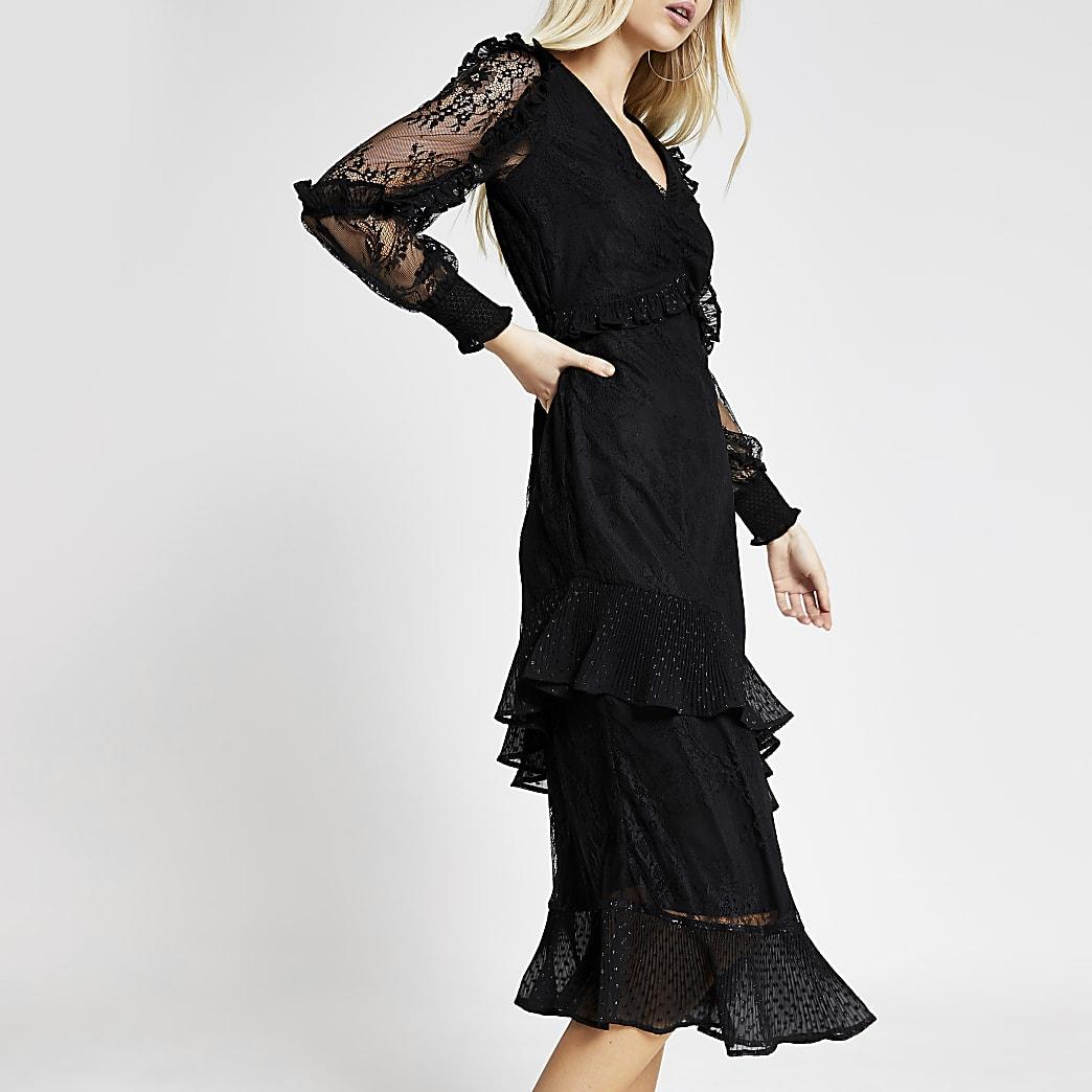 Robe mi-longue noire volantée en dentelle à mancheslongues