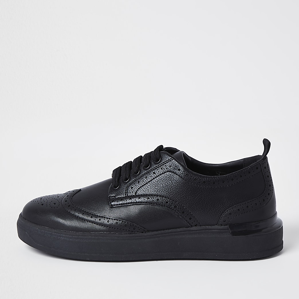 Black lace-up brogue wedge sole trainers