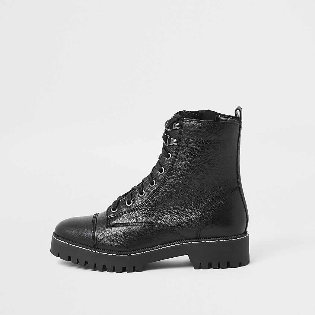 Black lace up flat hiker ankle boot