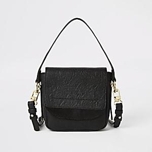 Schwarze, mit Verzierungen versehene Mini-Umhängetasche aus Leder