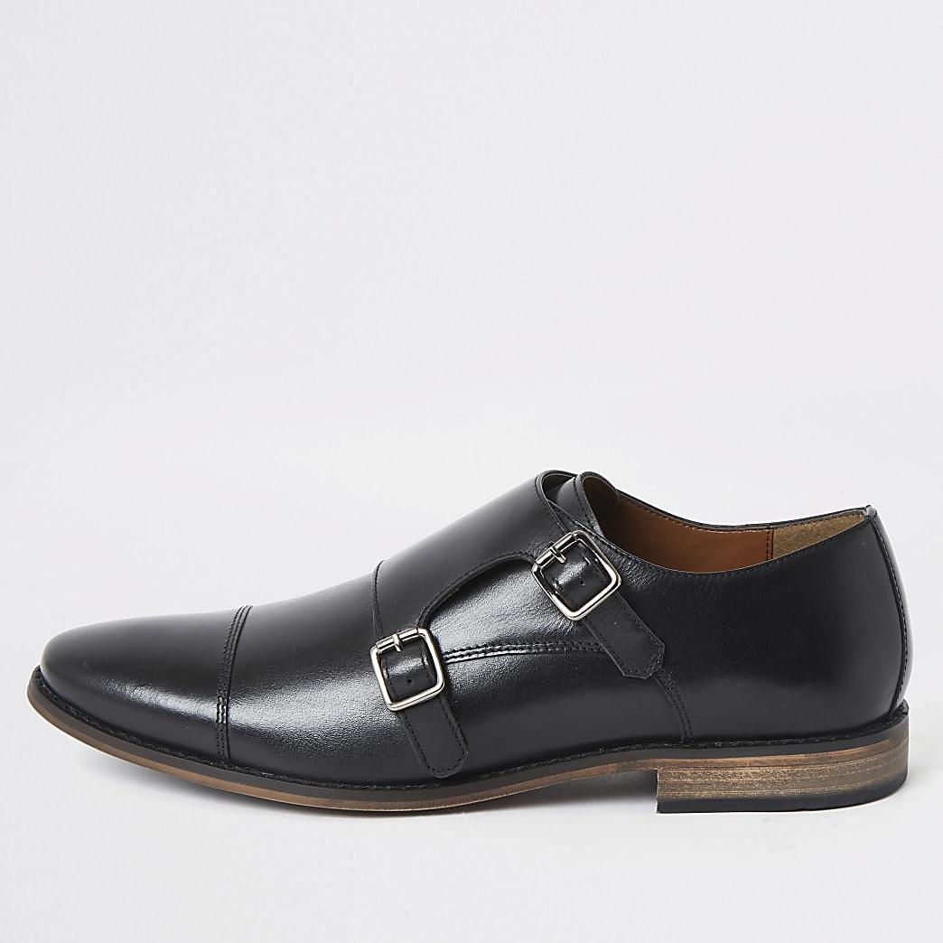 Zwarte leren derbyschoenen met dubbele gesp