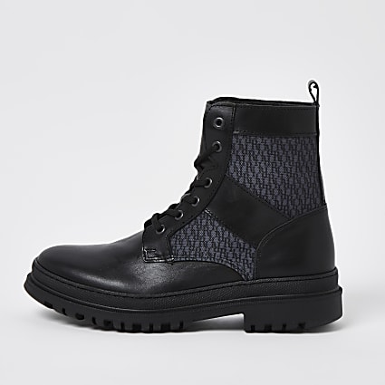 Black leather monogram lace up boots