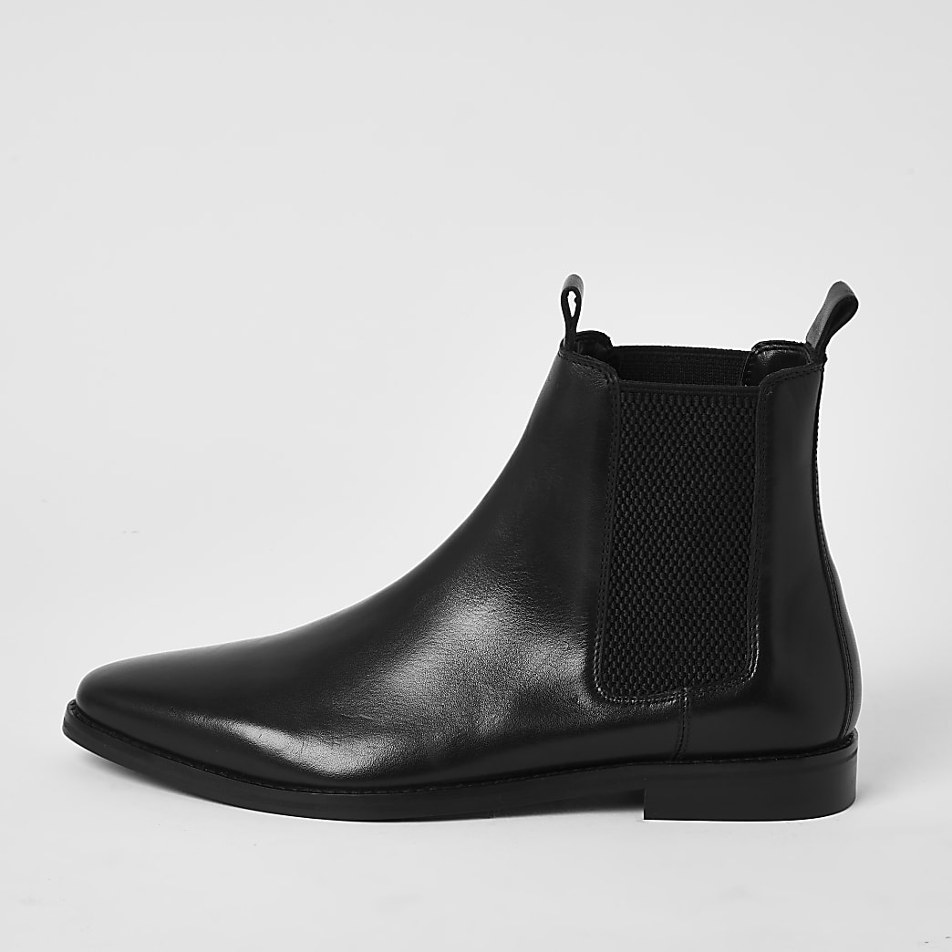 Black leather pull tab Chelsea boots