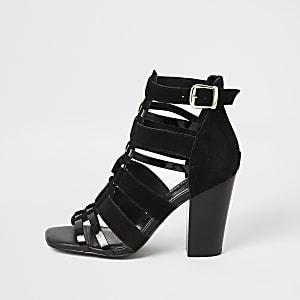 Sandales à talon en cuir noirà lanières