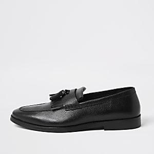 Zwarte leren loafers met kwastjes en franje