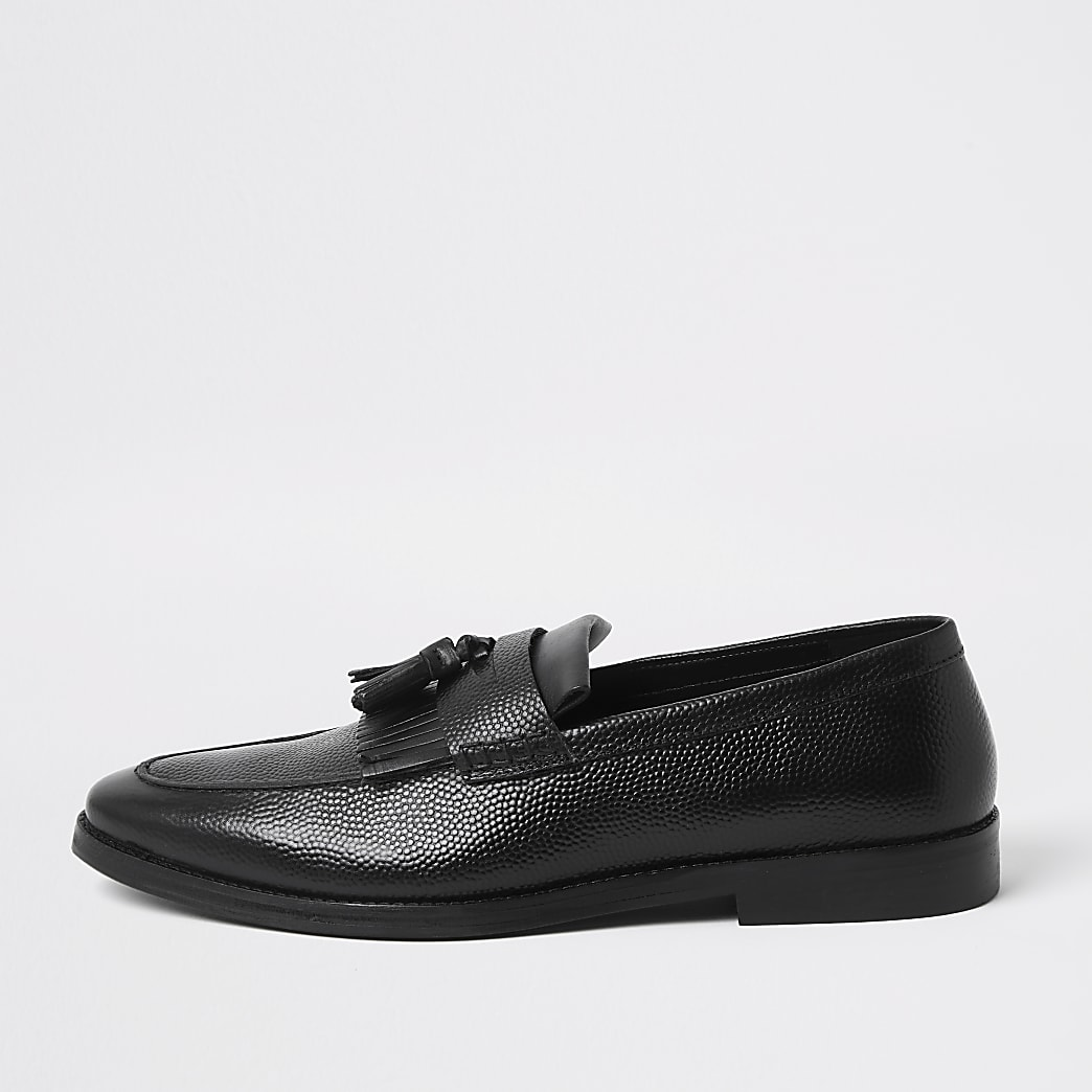 Black leather tassel fringe loafers