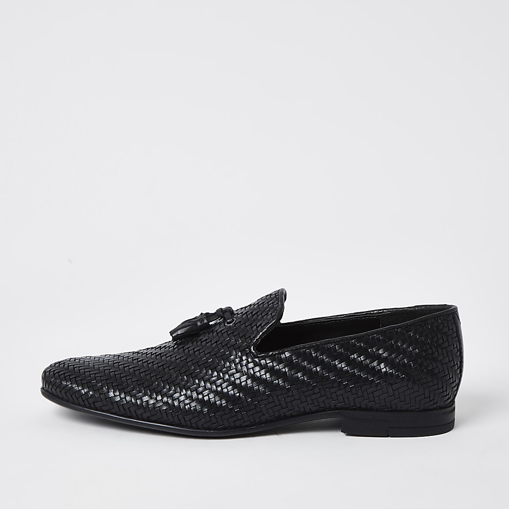 Black leather textured tassel loafers