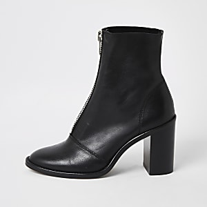 Bottesà talon noires en cuir zippées