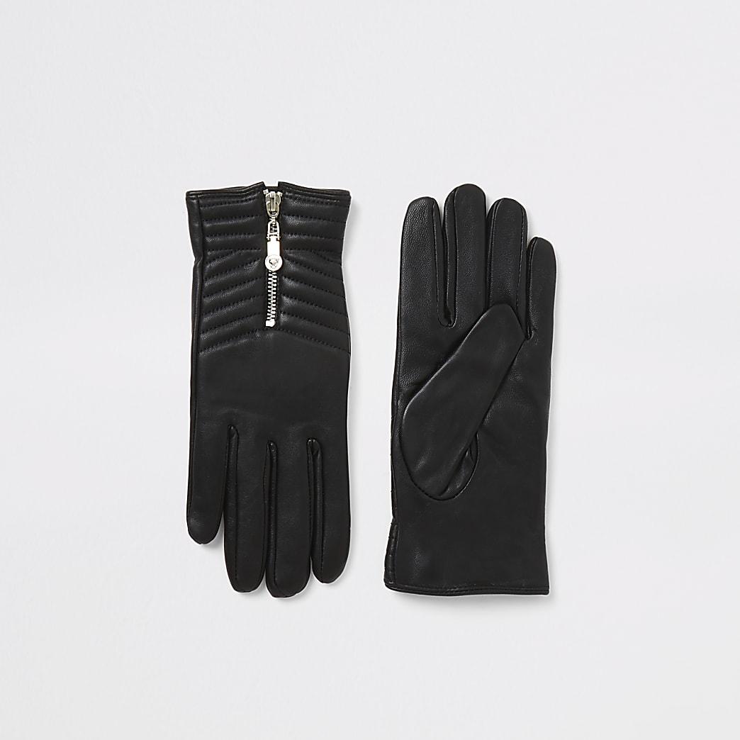 Schwarze, gesteppte Lederhandschuhe mit Reißverschluss in einer Box