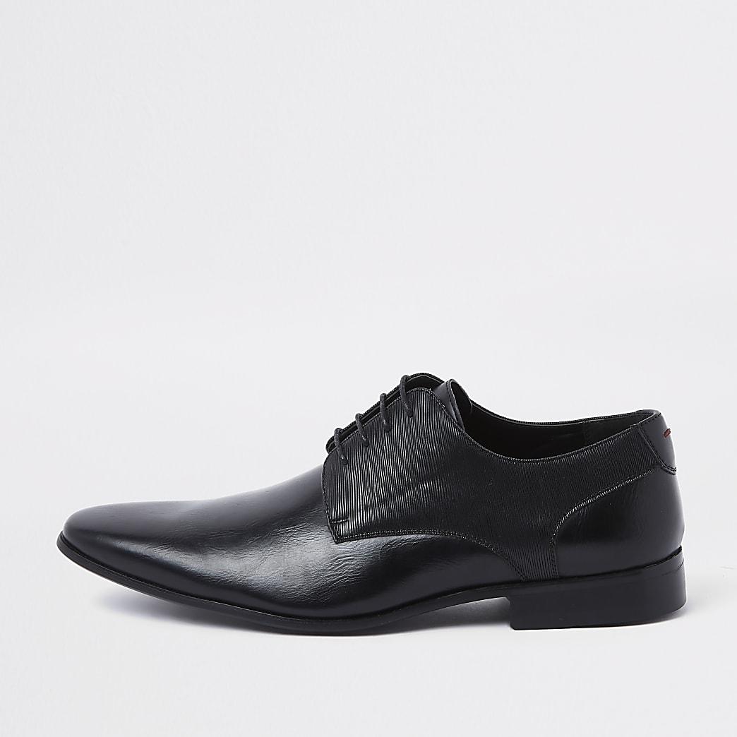 Chaussures Derby noires lacées à ligne en relief