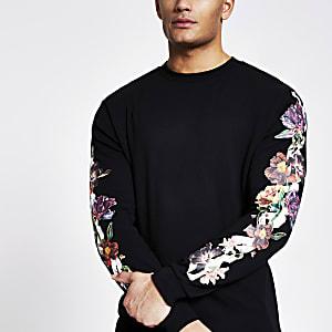 Schwarzes T-Shirt mit langen Blumenprint-Ärmeln