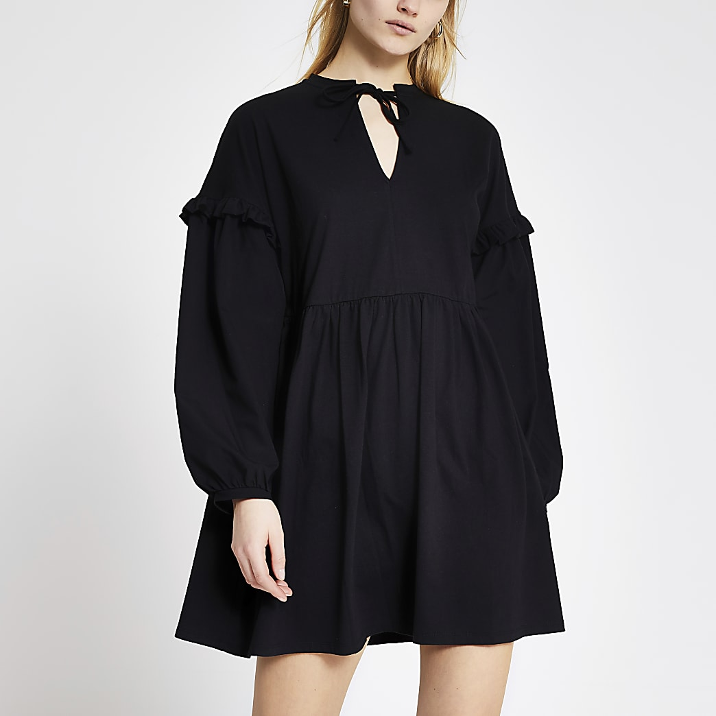 Mini-robe noire à manches longues en popeline