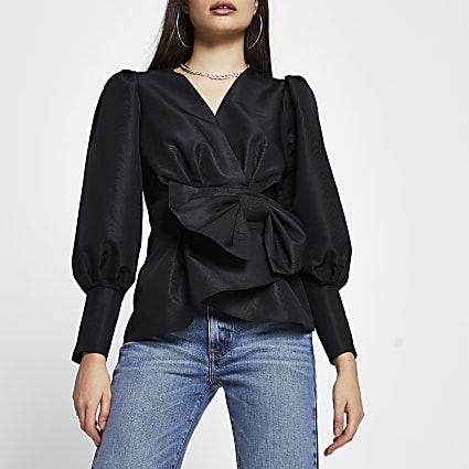 Black long sleeve bow peplum top