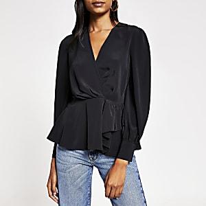 Zwarte blouse met peplum, lange mouwen en overslag