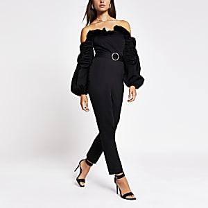 Zwarte jumpsuit met bardothals, lange mouwen en ruches