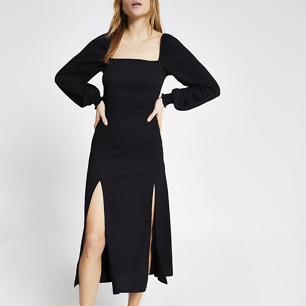 Robe mi-longue noire à taille froncée et manches longues
