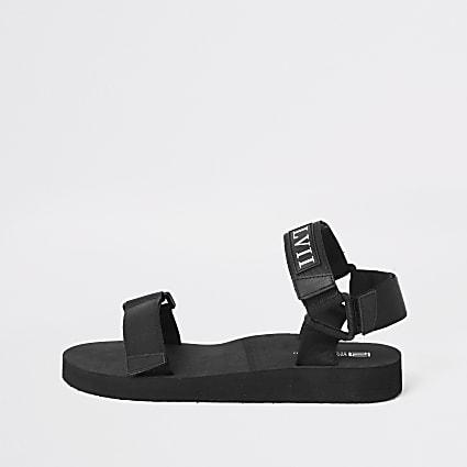 Black 'LVII' velcro strap sandals