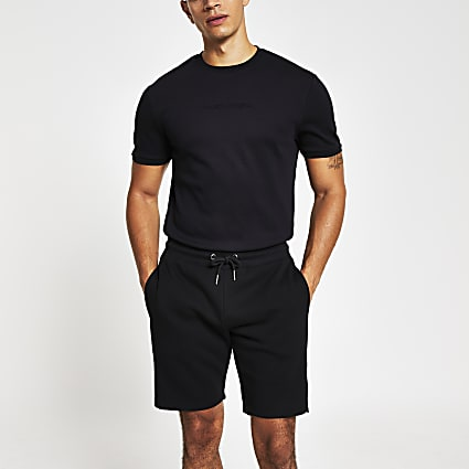 Black Maison Riviera embossed slim fit shorts