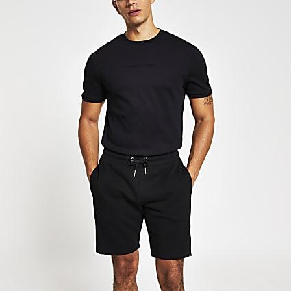 Black Maison Riviera embossed slim fit shorts