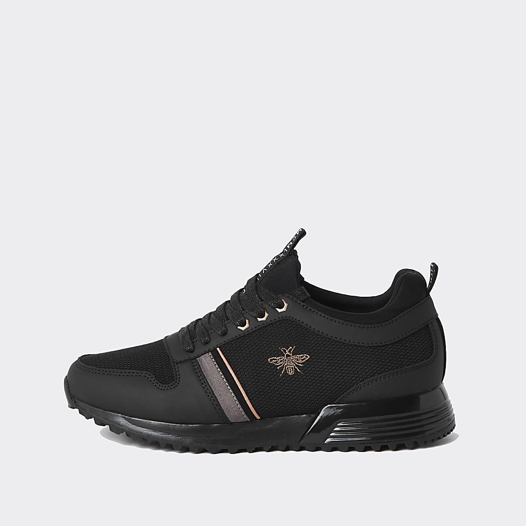 Zwarte vetersneakers met 'MCMLXXVI'-print