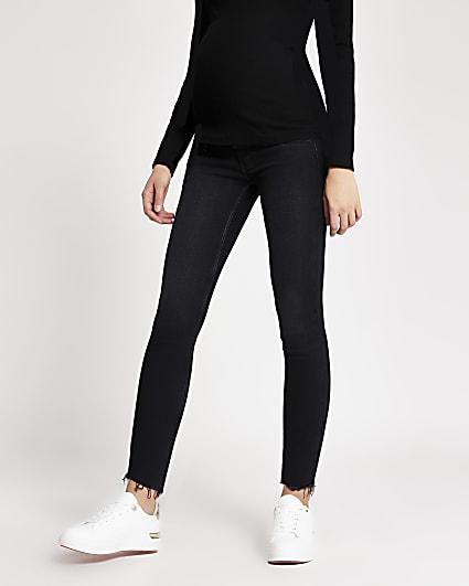 Black mid rise maternity skinny jeans