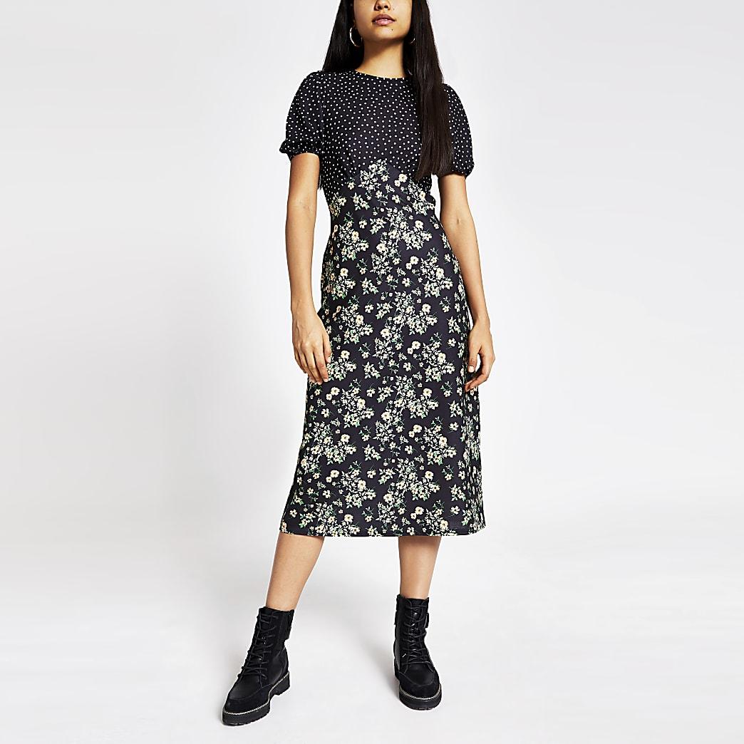 Zwarte midi-jurk met gemengde print en strik achter