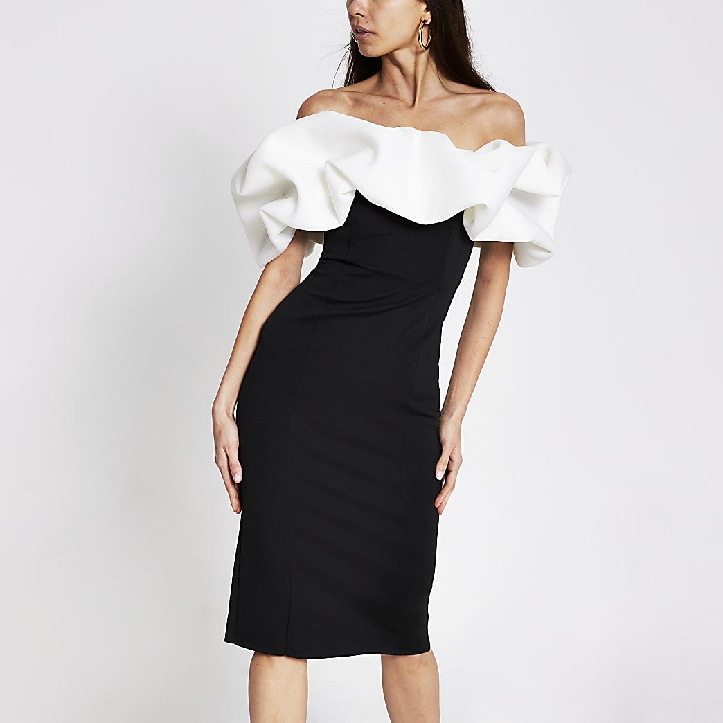 Robe moulante avec décolleté Bardot bouffant noire et blanche