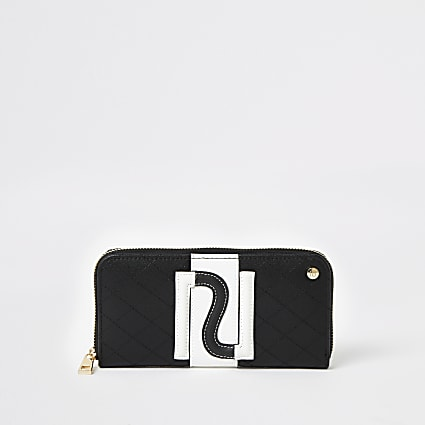 Black monochrome RI zip around purse