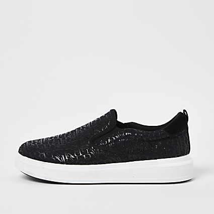 Black monogram slip on trainers