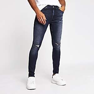 Black Ollie spray on skinny ripped jeans