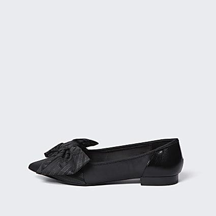Black oversized bow flat shoes